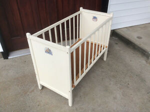 vintage wooden baby crib or dog bed