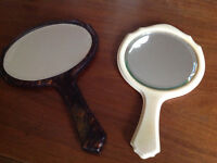 Two antique hand mirrors