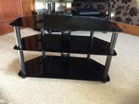 Corner Tv stand black glass.