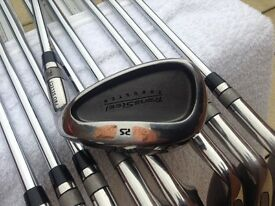 SET OF RIGHT HANDED CAVITY BACK IRONS TUNGSTEN WITH REGULAR STEEL SHAFTS.