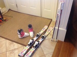Girls alpine skis and boots and poles