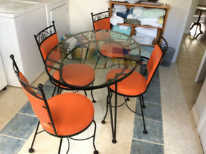 Retro glass table top and rod iron plus 4 chairs