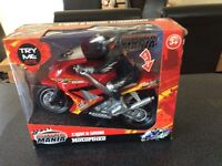 Brand new still in package, kids motor mania with sound effects, motorbike with rider