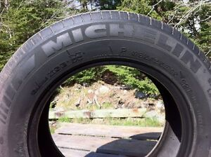 Pair of 205/65R15 and pair of 205/70R15 tires for sale.