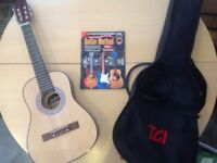 Half size children's classical guitar, bag and book