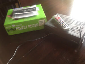Shaw satalite tv boxes, 1 HD 1 SD with remotes.
