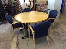 Oak round table and four blue fabric chairs
