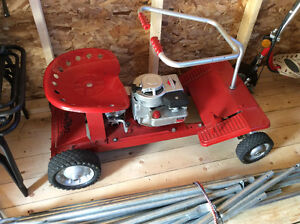 Old Murray lawn tractor     And a hockey table $200 plugs in .