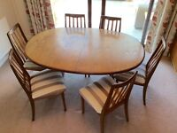 G Plan extending teak dining table with six chairs.
