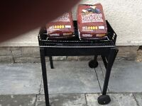 Unused barbeque for sale with charcoal wood