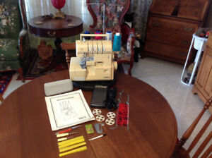 Omega Sewing Machine Serger and Accessories