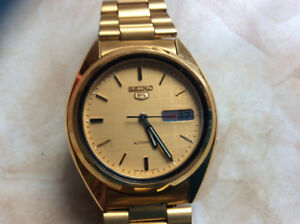Seiko.5self.winding.day.anddate.gold.braclet.plus.expansion.one