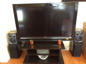 Tv and Stand - tv good for parts only - as is