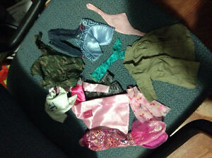 Collection of Barbie clothes for sale
