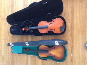 Two full size violins w/o strings or bows