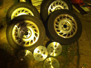 4 Tires, rims and hub covers like new forsale. $250.00 firm.