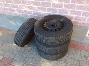 GOODYEAR INTEGRITY P195/70R14 SNOW TIRES AND RIMS