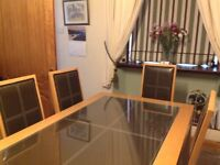 Brown leather effect dining table with 6matching chairs