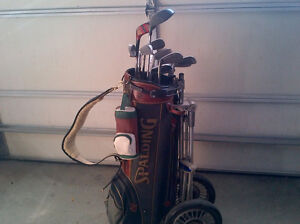 Complete set of golf clubs, golf bags, golf carts...extra clubs.