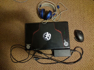 MSI GE70 Laptop with mouse and headset
