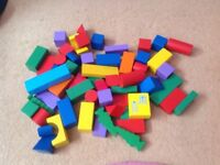 58 multi coloured wooden toy bricks
