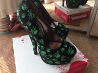Scull and canvas high heel
