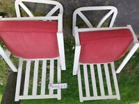 "Two ""not your ordinary"" patio chairs"