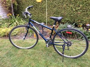 Vélo hybride Miele de 21 vitesses en parfaite condition.
