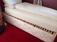 Electric riser single bed with mattress.