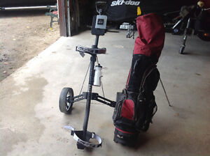 LEFT-handed Ram golf clubs and cart