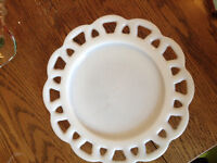 Set of different formal serving plates and bowls