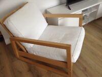 Swinging arm chair