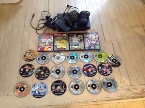 PS2 with games and remote controls
