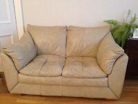 2 Cream leather 2 seater sofas