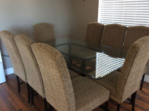 Glass dining room table with 8 chairs