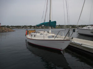 Junk rigged sailboat with wind pilot pacific light self steering