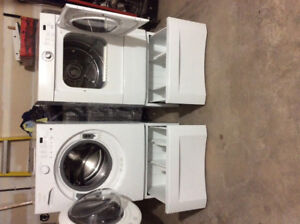 Frigidaire Washer and Dryer with base units.