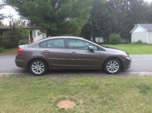 Honda civic ex-l 2012 gps.demareur,cuir.automatique. 1 taxe