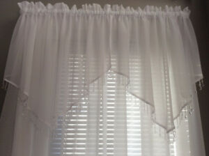 Sheer curtains and valances with crystal like trim. 2 sets.