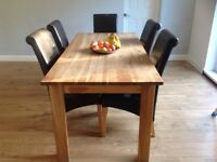 Large solid oak dining table and 6 chairs