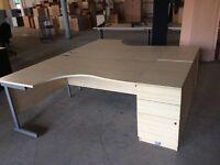 2 light oak desks with 2 pedestals