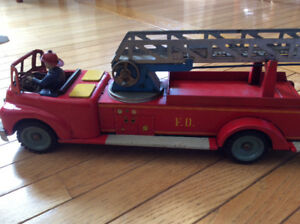Vintage metal fire truck with boom ladder