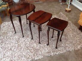 NEST OF THREE MAHOGANY FINISH TABLES