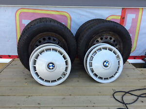 Winter tires with steel wheels and BMW hubcaps.