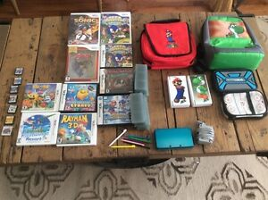 Nintendo 3DS console with Games and accessories and 3 Wii Games