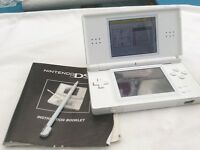 Nintendo ds lite with charger and games