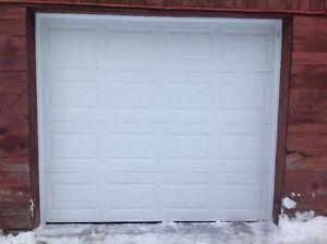 Garage door (non insulated) 9 x 6 under 2 yrs old, white.