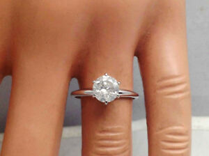 New 1.20 carat solitaire F diamond 14K gold ring. 10.300 CAD