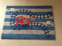 Next toddler train collection rug