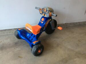 Child's solid plastic tricycle